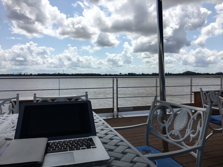 Photograph of Damian working from the sun deck